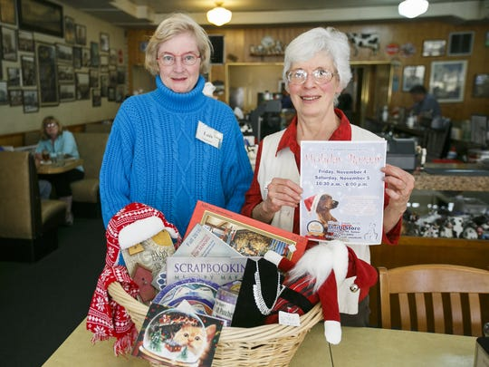 Lois Parker, left, and Kit Prohm display examples of items that will be for sale at the Willamette Humane Society Thrift Store's Holiday Bazaar this Friday and Saturday.