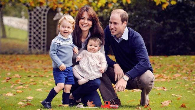 Britain's Prince William, right, Catherine, Duchess of Cambridge and their two children, Prince George and Princess Charlotte, in a photograph taken in late October 2015 at Kensington Palace in London.