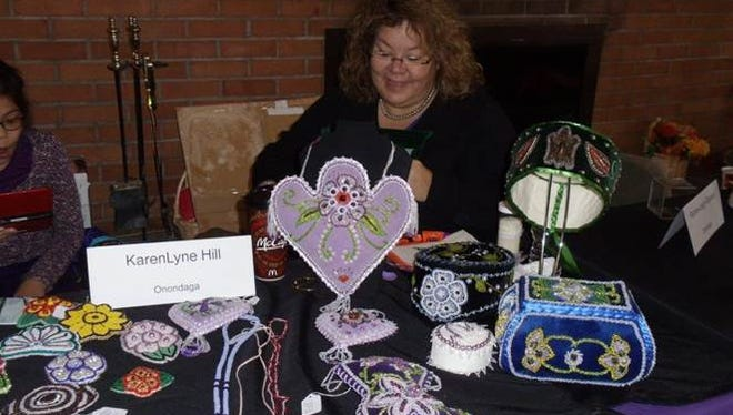 Onondaga beadworker KarenLyne Hill at last year's Otsiningo American Indian Art Market. Hill is a nationally known bead artist. She won a ribbon at the 2015 Santa Fe Indian Market.