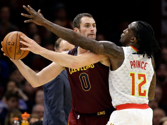 FILE - In this Nov. 5, 2017, file photo, Cleveland Cavaliers' Kevin Love (0) looks to pass against Atlanta Hawks' Taurean Prince (12) in the first half of an NBA basketball game in Cleveland. Love disclosed in an essay for the Players' Tribune on Tuesday, March 6, 2018, that he suffered a panic attack on Nov. 5 in a home game against the Hawks. He was briefly hospitalized at the Cleveland Clinic and the episode left him shaken.  (AP Photo/Tony Dejak, File)