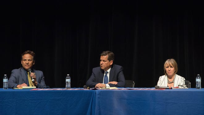 Jeff Apodaca,left, Joe Cervantes, center, and Michelle Lujan -Grisham, right, each candidate giving a one minute introduction during the 2018 Democratic Party of Doña Ana County Forum at the Rio Grande Theatre, Tuesday May 1, 2018. The forum is a three day event the next event is Wednesday May 2, and third Wednesday May 9 all at the Rio Grande Theatre.