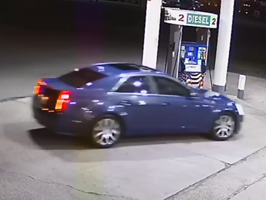 Suspect's vehicle is seen on camera at Outpost Travel