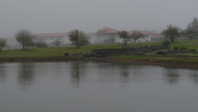 It's not every fishing hole that offers a view of a federal correctional facility, but Sheridan Pond shares a boundary with the prison.