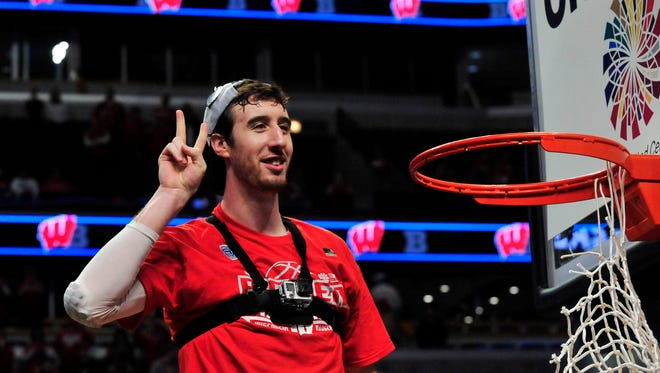 Wisconsin forward Frank Kaminsky waves to the crowd after cutting down a piece of the net after the championship game of the Big Ten Tournament.