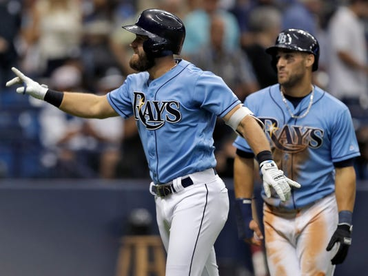 Tampa Bay Rays' Evan Longoria, left, celebrates with Kevin Kiermaier after hitting a two-run home run off New York Yankees starting pitcher Masahiro Tanaka during the second inning of a baseball game Sunday, April 2, 2017, in St. Petersburg, Fla. (AP Photo/Chris O'Meara)