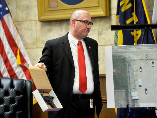 Cascade County Attorney Josh Racki shows the jury the pellet gun while delivering his closing arguments during the 2018 coroner's inquest on the fatal, officer-involved shooting of Stacy Micheletti.