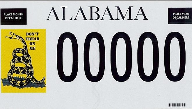 This photo provided by the Alabama Revenue Department shows a ?Don?t Tread on Me? license plate. At least 250 Alabama vehicles will soon bear license plates featuring the rattlesnake emblem popular with tea party groups. The state Revenue Department confirms the Montgomery-based Foundation for Moral Law has succeeded in getting 250 paid orders for the tags. Foundation President Kayla Moore said Tuesday, Sept. 16, 2014 the success is a reflection of public dissatisfaction with government.