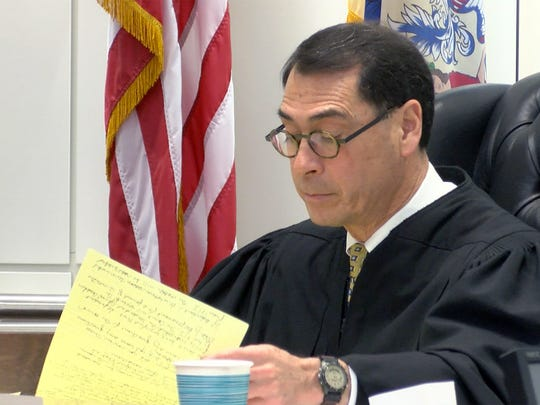 Superior Court Judge David Bauman goes through his notes as he accepts Former Monmouth County municipal judge Richard B. Thompson into the pretrial intervention program Thursday, March 22, 2018.  Thompson had pled guilty to charges that he falsified records as part of a five-year ticket-fixing scheme that funneled more than $500,000 to the municipalities that employed him.