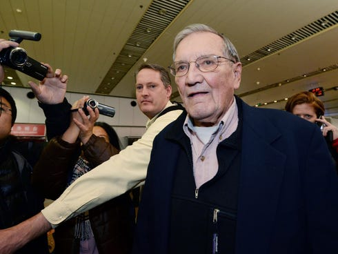 Merrill Newman arrives at the Beijing airport on Dec. 7, 2013 after being released by North Korea.