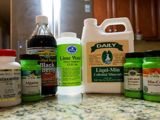 Various dietary supplements and viatmins John Dress