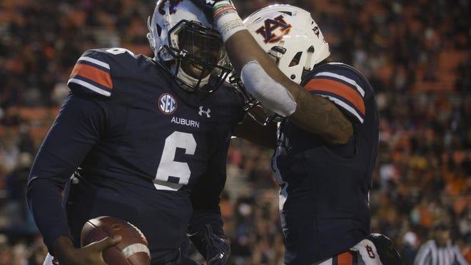 Auburn quarterback Jeremy Johnson celebrates with Auburn running back Kam Martin after scoring a touchdown against Alabama A&M.