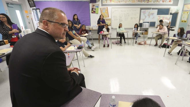Palm Beach County Deputy Schools Superintendent Keith Oswald speaks to students in a dual-language class at North Grade Elementary in Lake Worth.