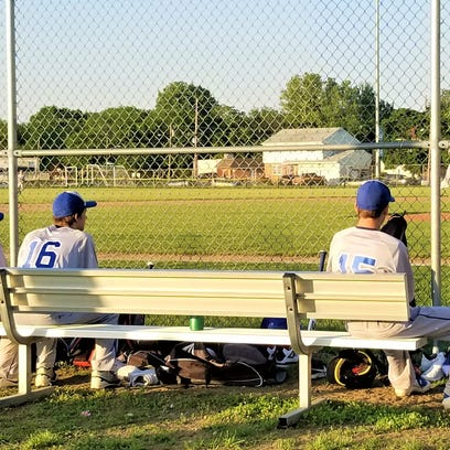 Burlington City High School baseball players watch