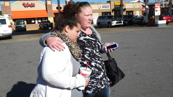 Karyssa Dalton, left,, is comforted by her friend, Christina Wilpers, during a search for Dalton's missing grandmother on Thursday, Dec. 1, 2016, in Pigeon Forge. Pamela Johnson, 59, who resided at the Travelers Motel on U.S. 321, hasn't been heard from since wildfire burned through Gatlinburg this week.