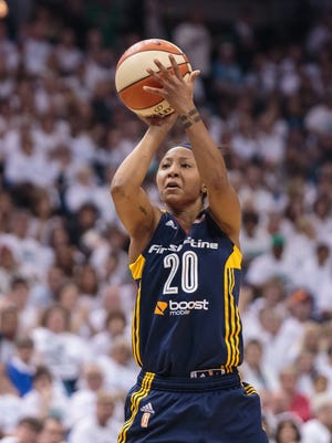 Oct 14, 2015; Minneapolis, MN, USA; Indiana Fever guard Briann January (20) shoots in the second quarter against the Minnesota Lynx at Target Center.