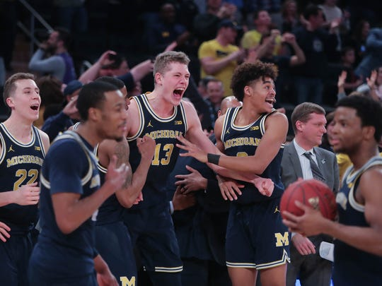 The Michigan Wolverines celebrate winning the Big Ten