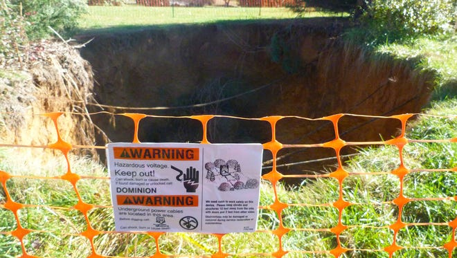 A recent sinkhole, located on a Dominion Virginia Power electric transmission line easement, appeared in September near Breezy Knoll Lane and Warren Oaks Lane exposing underground telephone, cable and high voltage electric lines.