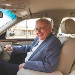 Investor Warren Buffett inside his  2006 Cadillac DTS.   Buffett's  car was auctioned for more than $122,000, about 10 times the estimated worth, as the billionaire and philanthropist offered to again help out one of his favorite charities. Buffett put the car  for sale on the website Proxibid, specifying that the money would be donated to Girls Inc. of Omaha. The car was valued at about $12,000.
