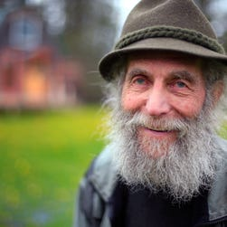 In this photo taken on May 23, 2014, Burt Shavitz poses on his property in Parkman, Maine.