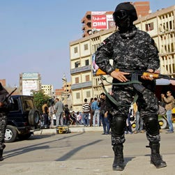 Masked Egyptian security forces deploy in the Cairo suburb of Matareya on the day Islamists called for nationwide demonstrations  Nov. 28, 2014.