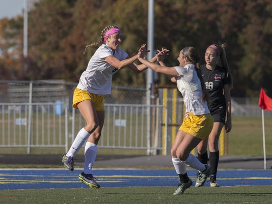 Toms River North's Jenna Royson celebrates with a team mate after she scored her team's first goal. Jackson Memorial Girls Soccer vs Toms River North in State Tournament game in Toms River on November 8, 2016