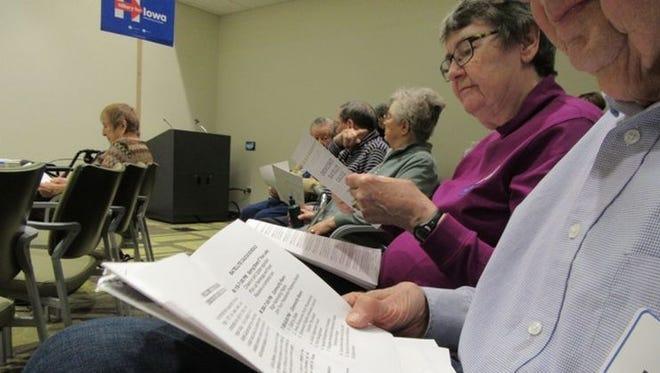 Democratic caucusgoers participate Monday in a satellite caucus site at Oaknoll Retirement Community in Iowa City.