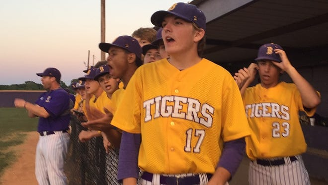 The Benton dugout cheers for pitcher Will Hine against Neville Friday evening.