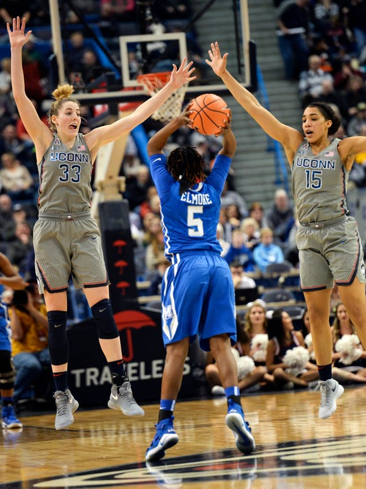 Connecticut's Katie Lou Samuelson (33) and Gabby Williams (15) guard against Memphis' Brea Elmore (5) in the first half of an NCAA college basketball game Sunday, Dec. 31, 2017, in Hartford, Conn. (AP Photo/Stephen Dunn)