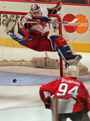 U.S. goalie Mike Richter deflects a shot on the way to winning the World Cup of Hockey in 1996