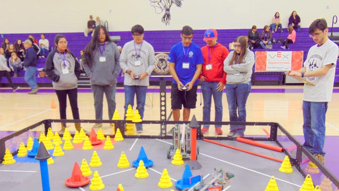 The Mescalero STEM team is pitted against the Truth of Consequences Hot Springs High School team in the competition arena.
