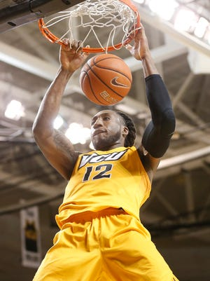 Virginia Commonwealth Rams forward Mo Alie-Cox (12) dunks the ball against the Richmond Spiders during the second half at Stuart Siegel Center. The Rams won 87-74.