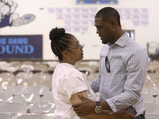 Chapin Basketball Coach Toraino Johnson talks with Tucker's mother Regina Tucker during a prayer vigil for Tucker's wife Genesis and their daughter who were seriously injured in a van accident that killed Tucker.