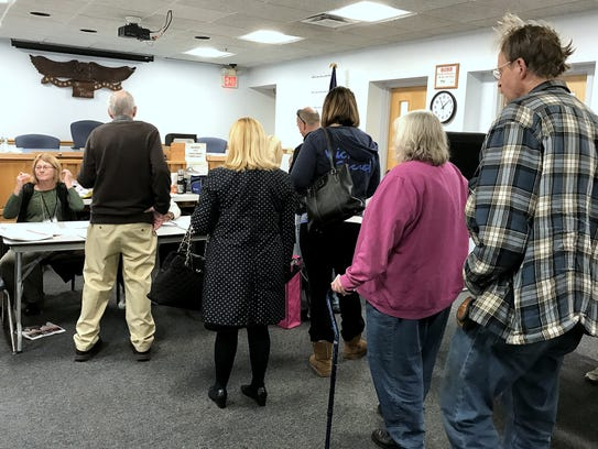 People stand in line to vote Tuesday morning at the