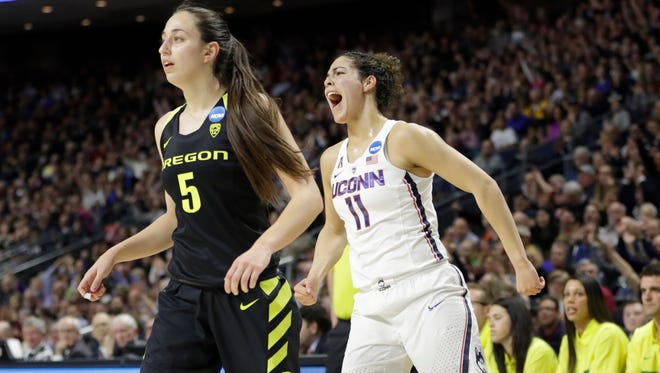Mar 27, 2017; Bridgeport, CT, USA; Connecticut Huskies guard Kia Nurse (11) reacts after her three point basket against Oregon Ducks guard Maite Cazorla (5) during the first half in the finals of the Bridgeport Regional of the women's 2017 NCAA Tournament at Webster Bank Arena. Mandatory Credit: David Butler II-USA TODAY Sports