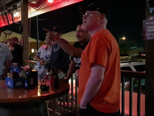 Robert Martinez Jr. (from right) and Danny Martinez watch the Houston Astros play in Game 1 of the World Series on Tuesday, Oct. 24, 2017, at Brewster Street Ice House in Corpus Christi.