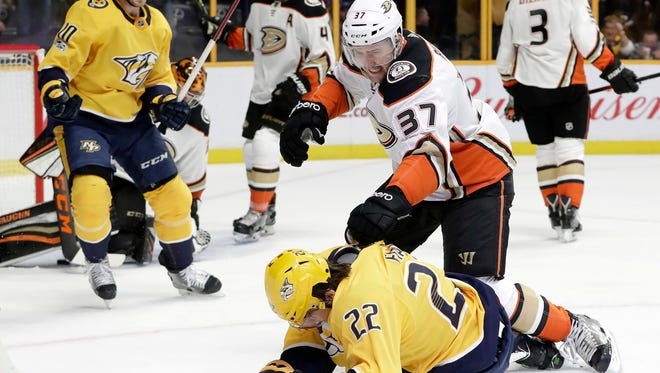 Anaheim Ducks left wing Nick Ritchie (37) knocks down Nashville Predators left wing Kevin Fiala (22) after Fiala scored a goal in the second period, Dec. 2, 2017, in Nashville, Tenn. Ritchie was penalized for roughing.