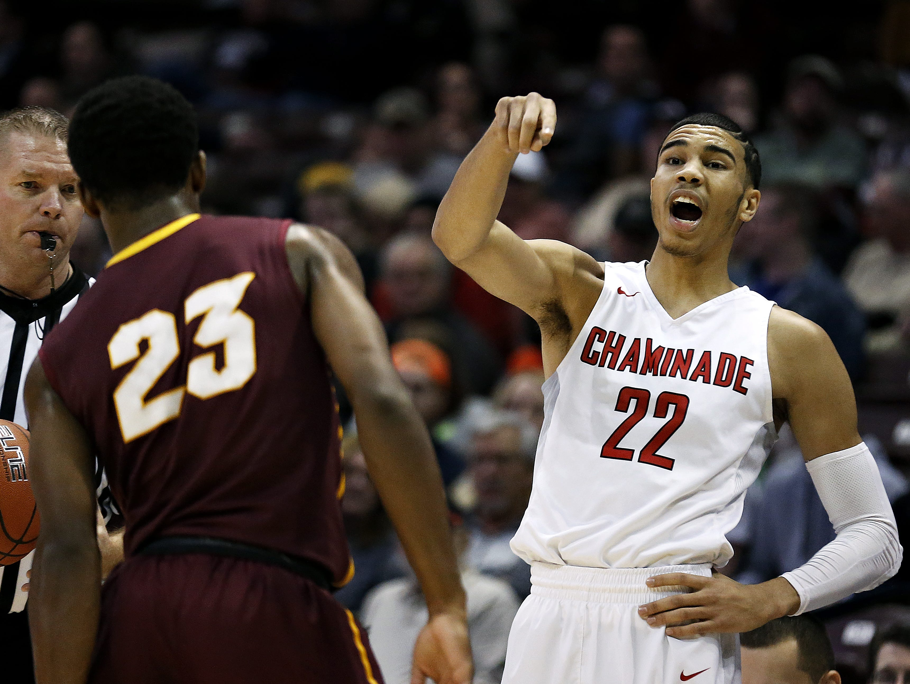 Chaminade College Preparatory School forward Jayson Tatum (22) yells out instructions to his teammates during first-quarter action of a 2016 Tournament of Champions game against Christ The King High School at JQH Arena. The Red Devils won the game 67-48.