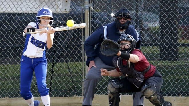 Lacey O'Donnell of Horseheads tries for a slap hit against Ithaca on Tuesday at Horseheads' home field on Broad Street.