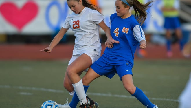 Madison Central's Maggie Overby (4) tries to steal the ball from Brandon's Kara Carter (29) during the Class 6A championship on Saturday. MC finished No. 1 and Brandon No. 2 in The Clarion-Ledger's final girls soccer rankings.