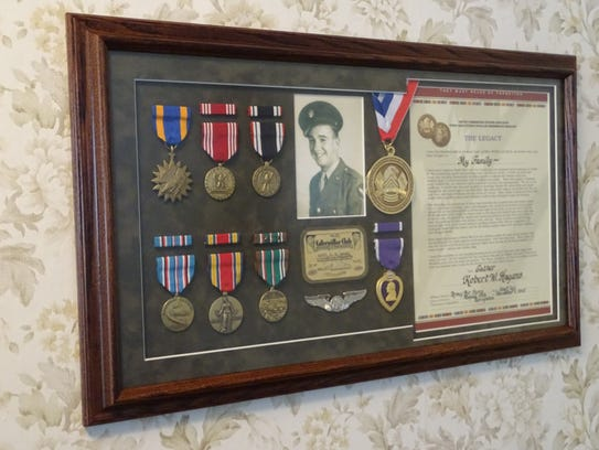 These medals and mementos remind Bill Hagans of his
