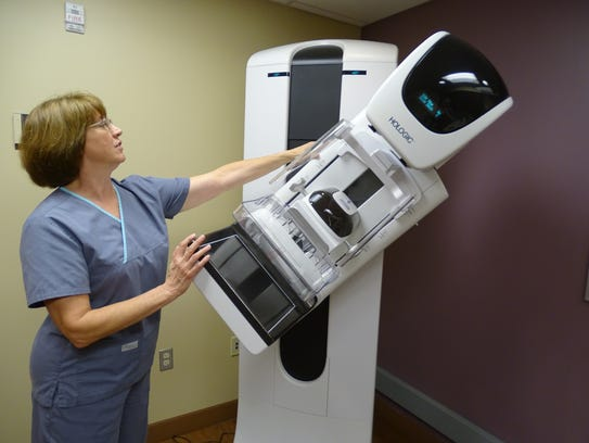 Arlene Donaldson, a 3-D mammography technician at ProMedica hospital in Fremont shows how 3-D X-ray technology rotates around the breast to take more than 150 pictures of breast tissue.