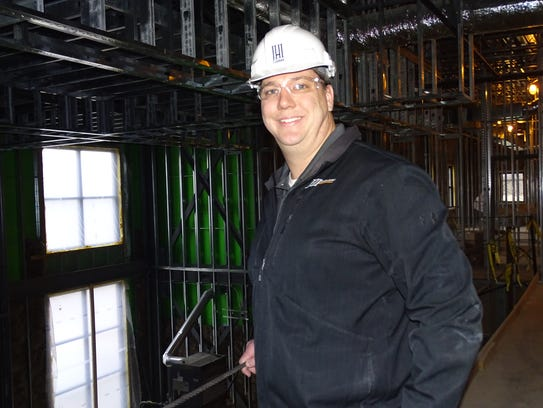 Janotta and Herner project manager Ryan Bickley stands