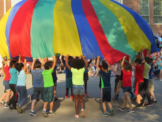 Bearden third graders do a parachute dance to a tune