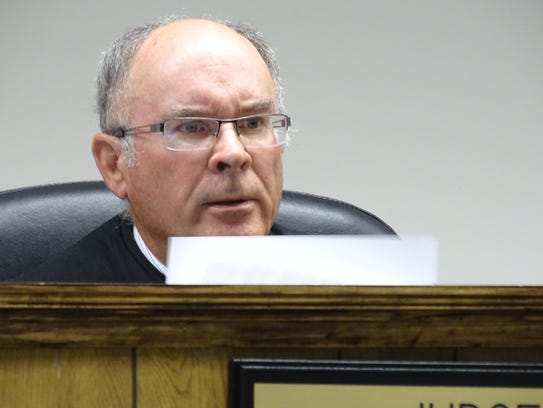 Judge John Dewey reads the charges against Daniel Myers