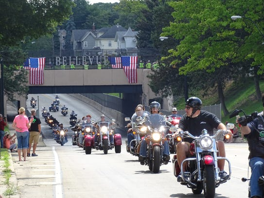 Hundreds of motorcyclists escort the truck carrying