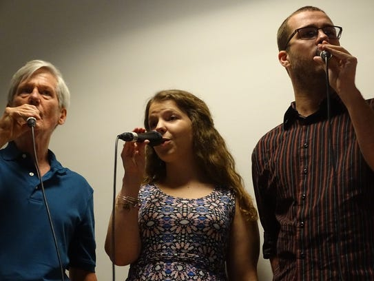 Members of the vocal jazz group CB Singers perform