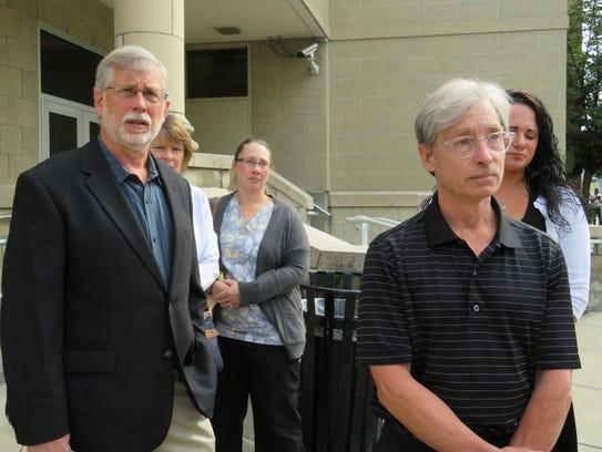Kurt Weber, left, and Jon Weber, right, speak outside