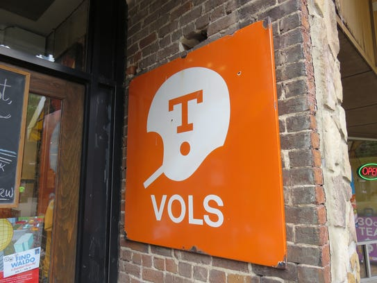 Vintage sign featuring Tennessee Vols football logo