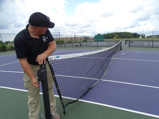 Fremont City Schools head groundskeeper Cory Hull tightens