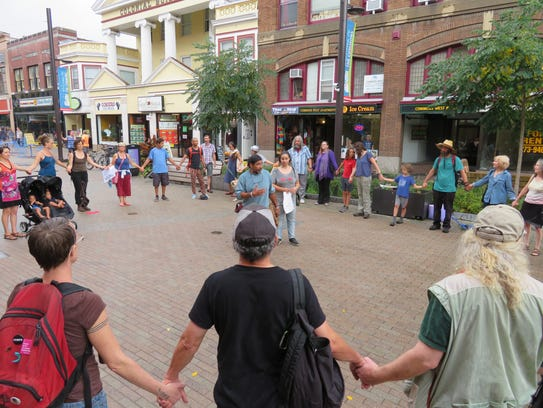 Dozens of people formed a circle and held hands after